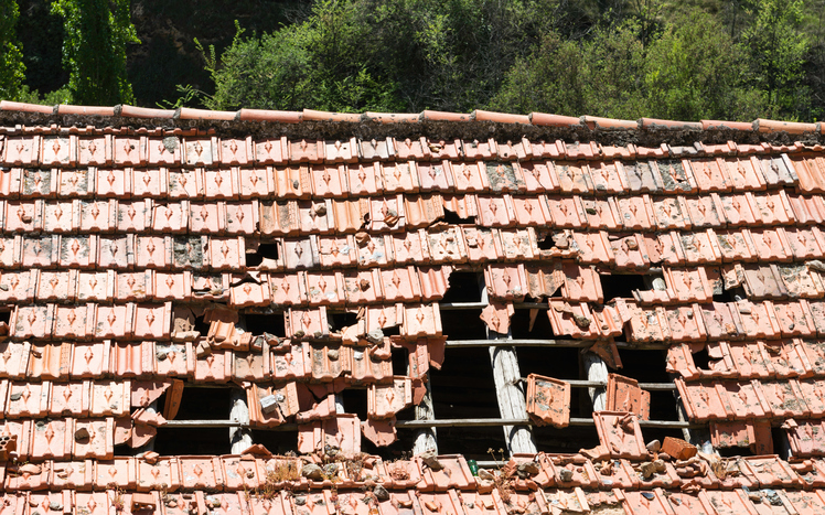 Huricane damaged tiled roof | Bufete Property Damage Lawyers
