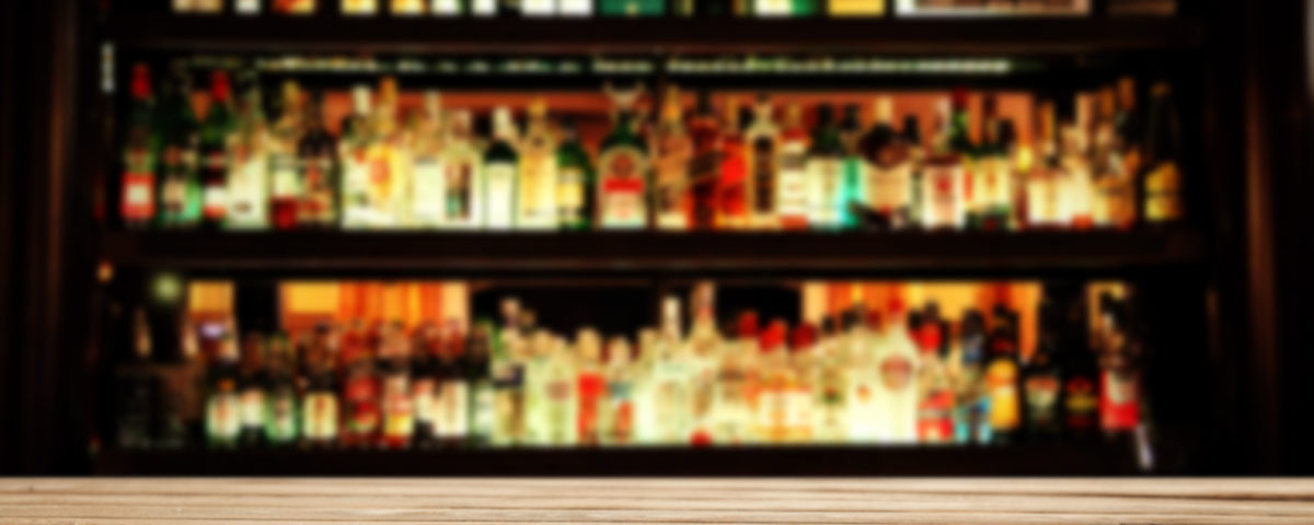 bar with alcohol in the background
